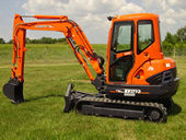 The KX121-3 Compact Excavator with Angle Blade
